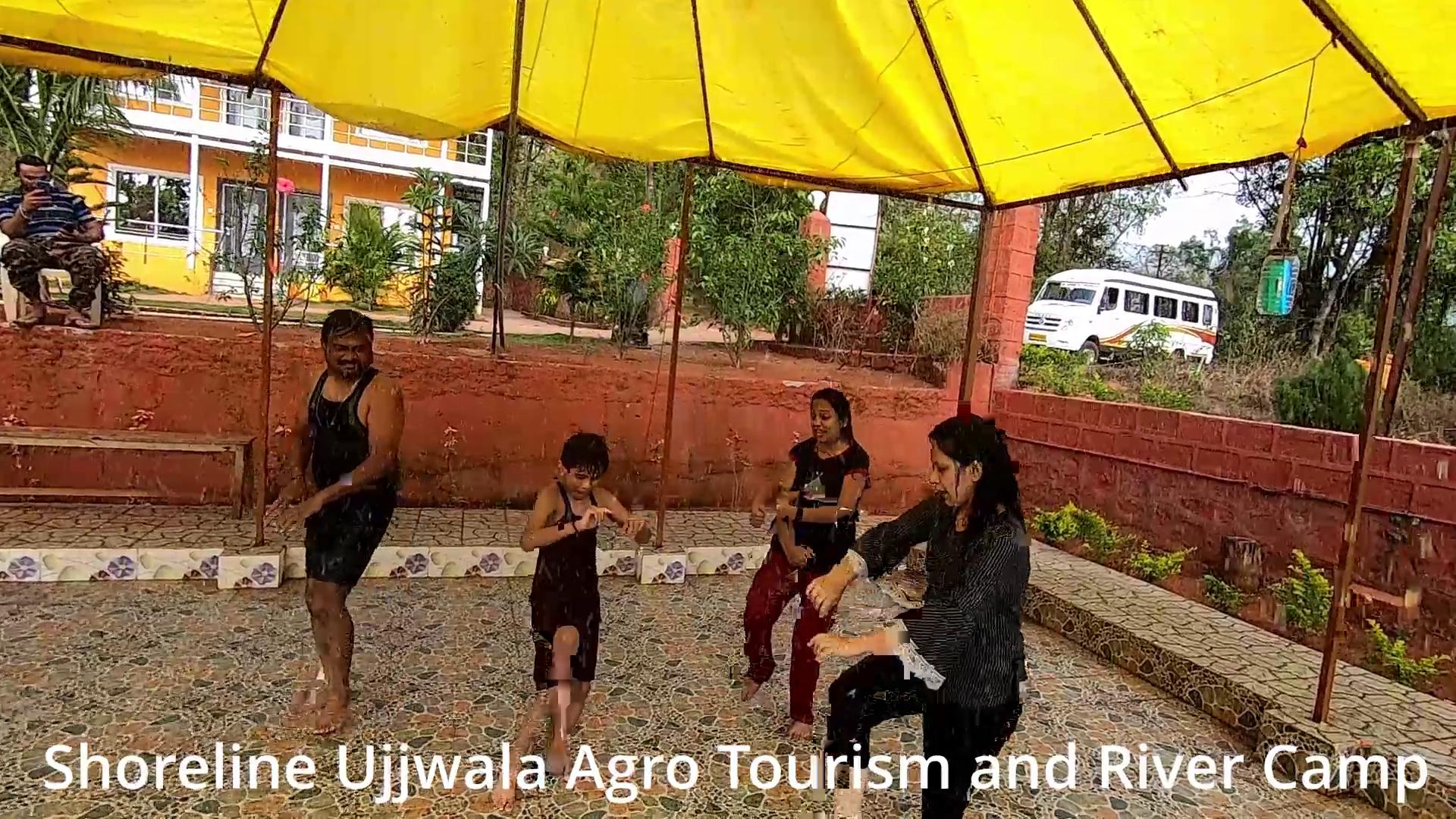 rain dance at Shoreline Ujjwala Agro Tourism and River Camp